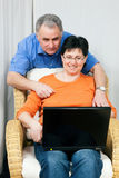 Senior couple surfing Internet Stock Images