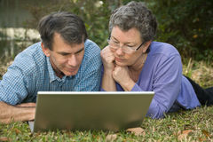 Senior Couple Surfing the Web Royalty Free Stock Photography