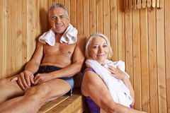 Senior couple sweating in sauna. Senior couple sweating and smiling together in a hotel sauna Royalty Free Stock Photos