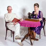 Senior couple at the table Royalty Free Stock Photo
