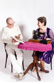 Senior couple at the table royalty free stock photography