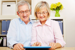 Senior couple with tablet computer browsing internet Stock Photos