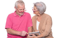 Senior couple with tablet Stock Photography