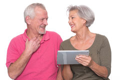 Senior couple with tablet Stock Images