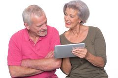 Senior couple with tablet Royalty Free Stock Photography