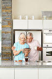 Senior couple with tablet computer in kitchen Stock Photography