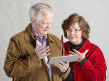 Senior Couple with Tablet Royalty Free Stock Images