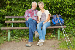 Senior couple taking break on bench Stock Images