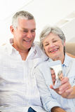 Senior couple taking picture through mobile phone Stock Photo