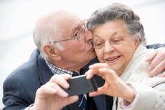 Senior couple taking selfie stock photo