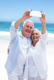 Senior couple taking a selfie Royalty Free Stock Photos
