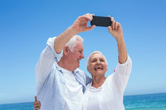 Senior couple taking a selfie Royalty Free Stock Images