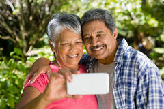 Senior couple taking selfie from mobile phone royalty free stock photo