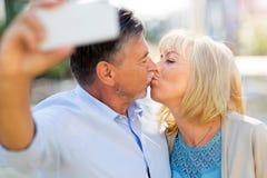Senior couple taking selfie. Outdoors Stock Images