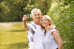 Senior couple taking selfie Royalty Free Stock Images