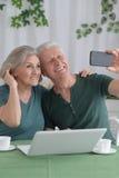 Senior couple taking selfie Royalty Free Stock Image