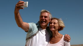 Senior couple taking a selfie on sunny day stock footage