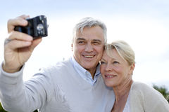 Senior couple taking selfie on a sunny day Royalty Free Stock Image