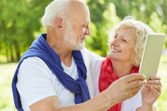 Senior couple taking selfie with tablet computer Stock Photos