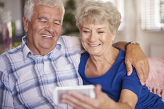 Senior couple taking a selfie together Royalty Free Stock Photo