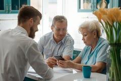Senior couple talking with advisor royalty free stock photos