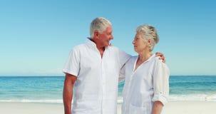 Senior couple talking. On the beach stock video