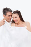 Senior couple talking in bed Royalty Free Stock Photo