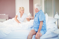 Senior couple talking in bedroom. At home Stock Photos