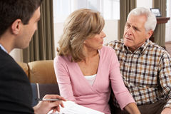 Senior Couple Talking With Financial Advisor Stock Images