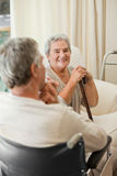 Senior couple talking in a hospital room Stock Photo