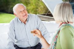 Senior Couple Talking While Playing Dominoes Stock Photos