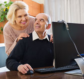 Senior couple talking with someone Stock Photography