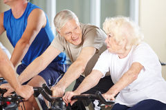 Senior couple talking in spinning Royalty Free Stock Photo