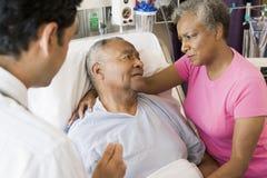 Senior Couple Talking To Doctor Royalty Free Stock Photos