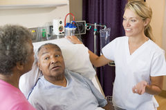 Senior Couple Talking To Doctor. In Patients Room stock photos