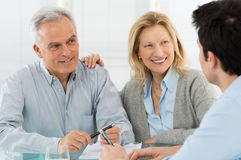 Senior Couple Talking With A Consultant Stock Photo