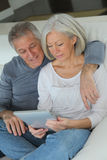 Senior couple and technology Royalty Free Stock Photos