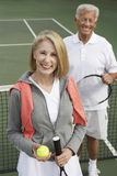 Senior Couple In Tennis Court Stock Images