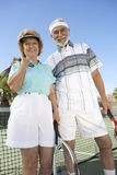 Senior Couple On Tennis Court Stock Photography