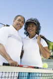 Senior Couple At Tennis Court Stock Images