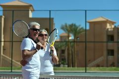 Senior couple on tennis court Stock Image
