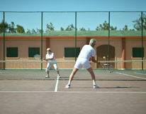 Senior couple on tennis court Royalty Free Stock Photo