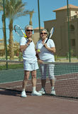 Senior couple on tennis court Stock Images