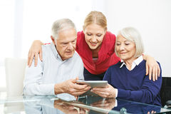 Senior couple testing apps on tablet computer Stock Images