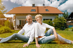 Senior couple and their garden home Royalty Free Stock Image