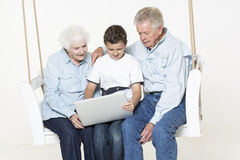 Senior couple with their grandson Stock Image