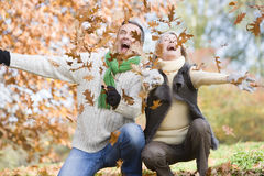 Free Senior Couple Throwing Leaves In The Air Royalty Free Stock Image - 5307246