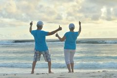 Senior couple with thumbs up. Happy Senior couple with thumbs up  in summer on  seashore Stock Photography