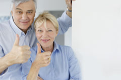 Senior couple with thumbs up Royalty Free Stock Photo