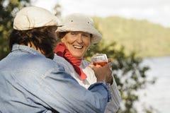 Senior couple toast each other Stock Image